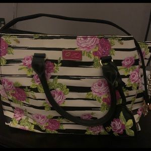 Woman's handbag by betsey Johnson floral design